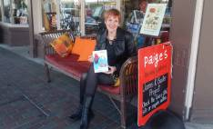 Author Katherine Dewar with a copy of Ruby and the Blue Sky at Paige's Book Gallery Whanganui